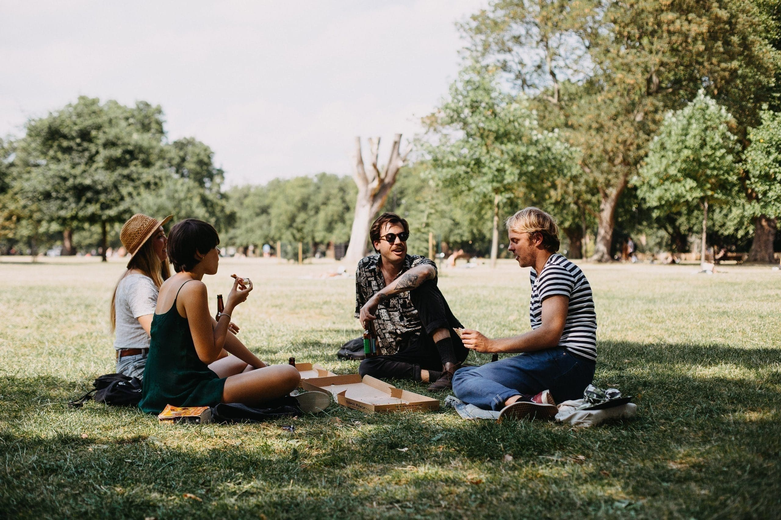 Young people having a picnic in the park