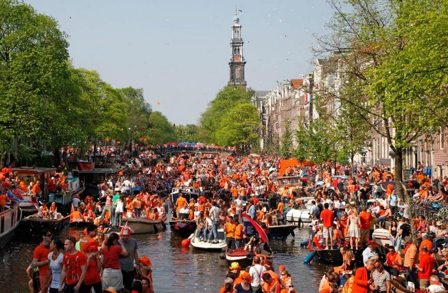 Amsterdam Kings day Canals How to make the most of kings day Clink Hostels